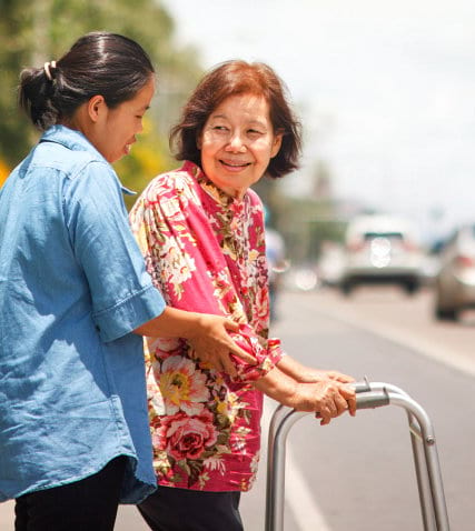portrait of asian caregiver and senior woman