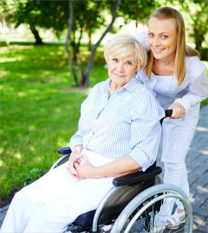 portrait of senior woman and caregiver outside