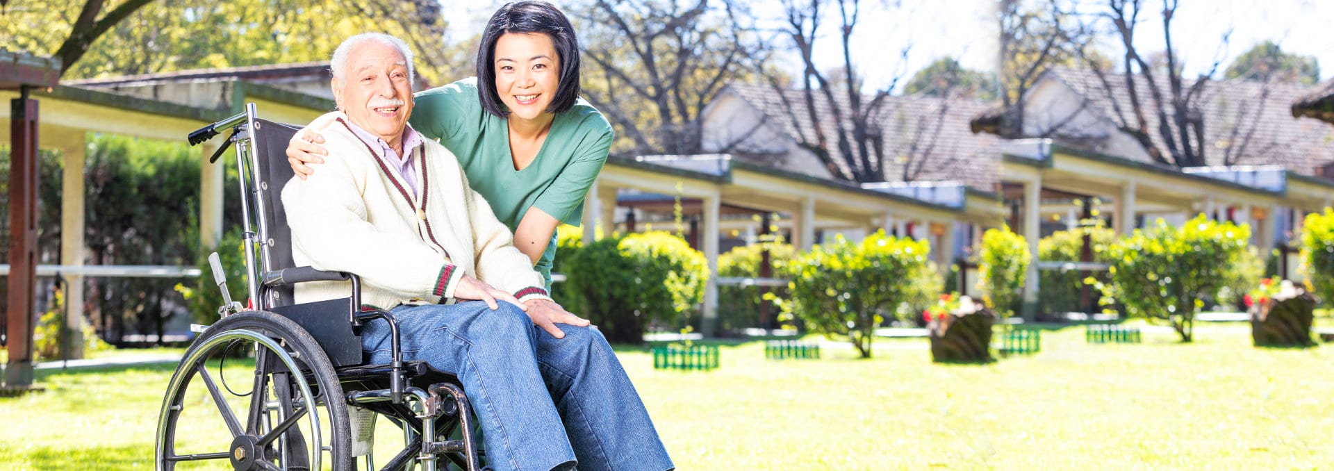 portrait of caregiver and senior man